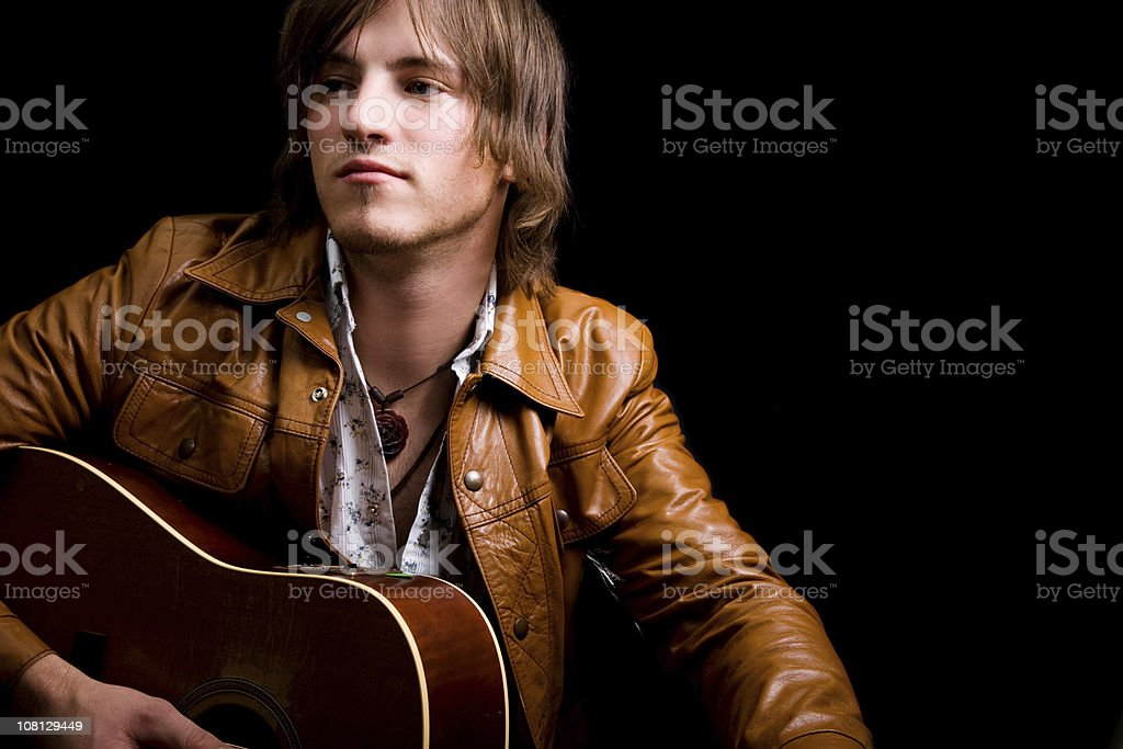 Young Male Holding Guitar stock photo