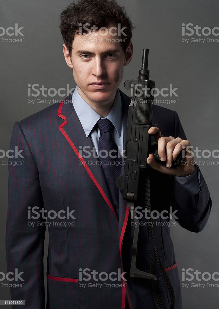 Young Male In Designer Suit With An Uzi Gun stock photo