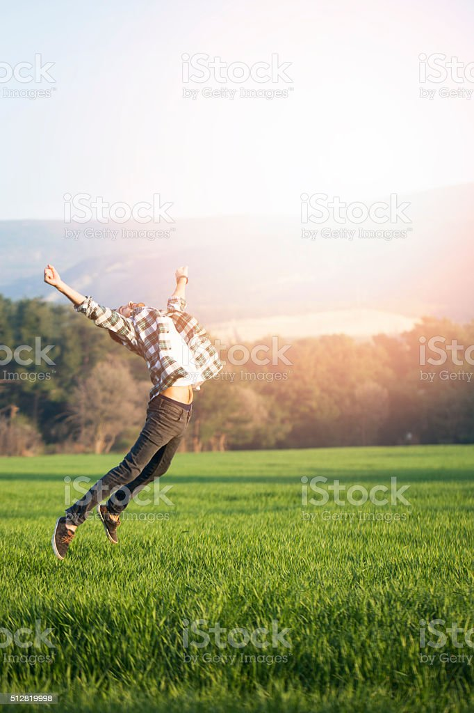 Young Male Jumping stock photo