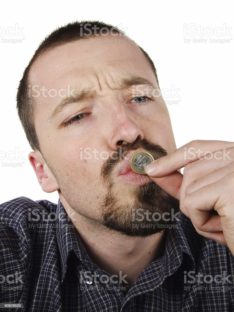 Young male kissing a 1 Euro coin stock photo