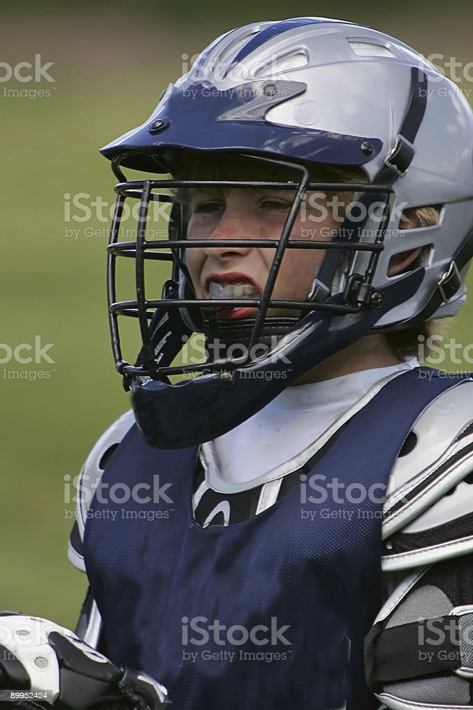 Young Male Lacrosse Player Grimaces in Headshot stock photo