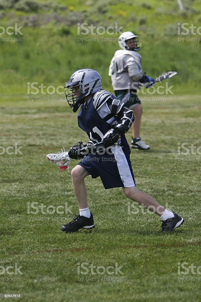 Young Male Lacrosse Player on Attack royalty-free stock photo