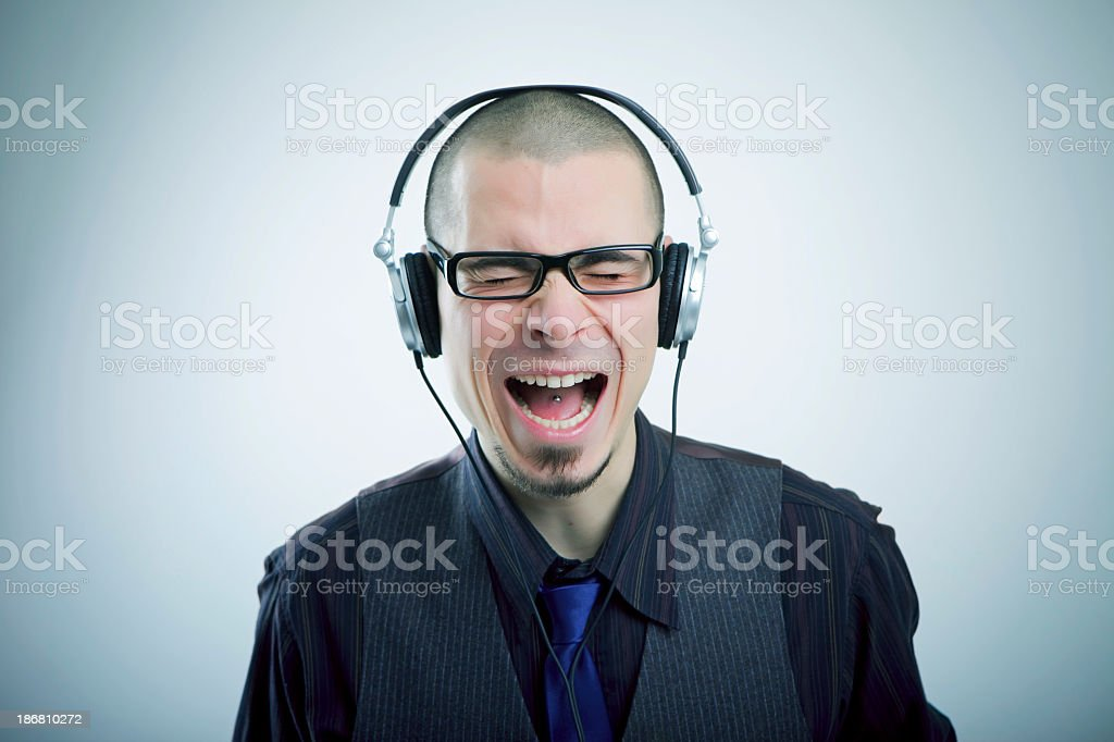 Young male listening to the headphones royalty-free stock photo