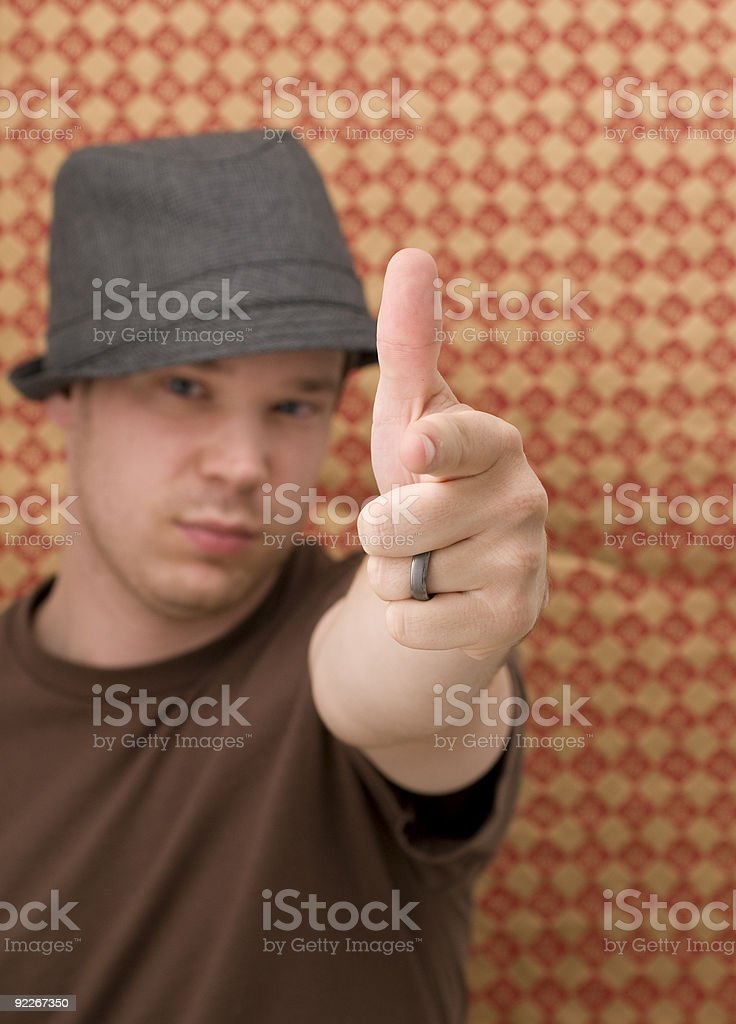 Young Male Making Shooting Gesture stock photo