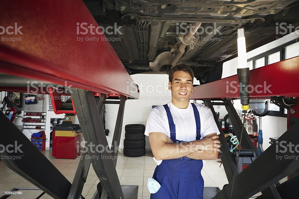 A young male mechanic photographed at work royalty-free stock photo