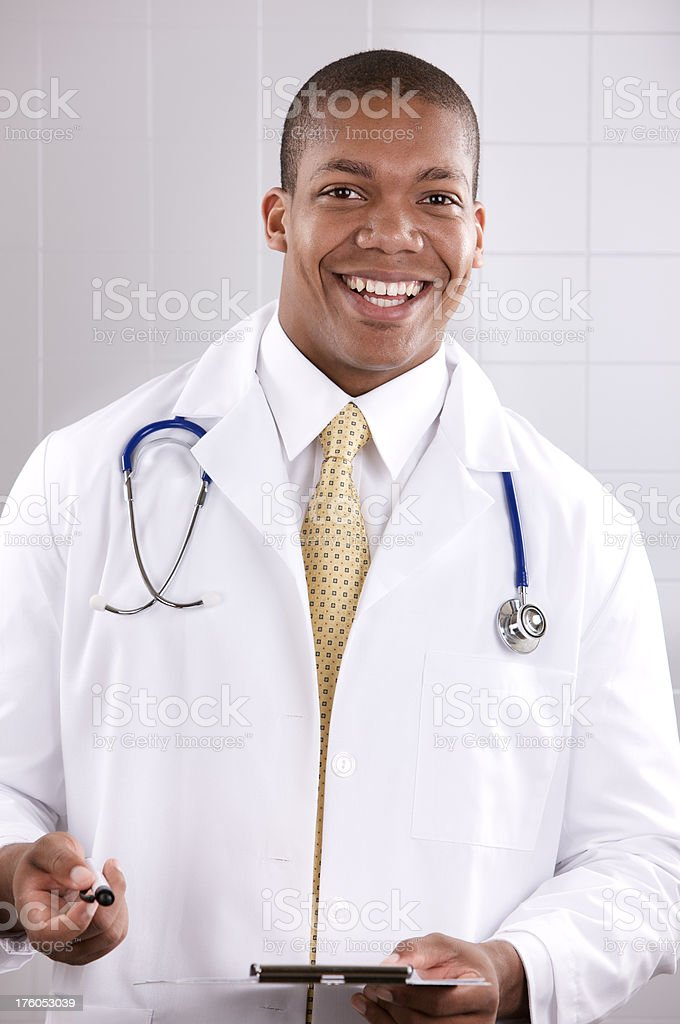 Young male medical professional smiling at camera royalty-free stock photo