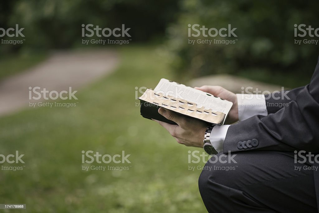 Young Male Missionary Reading from the Bible stock photo