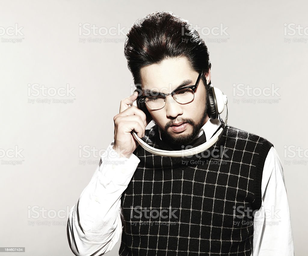 Young Male Model listening to Headphones stock photo