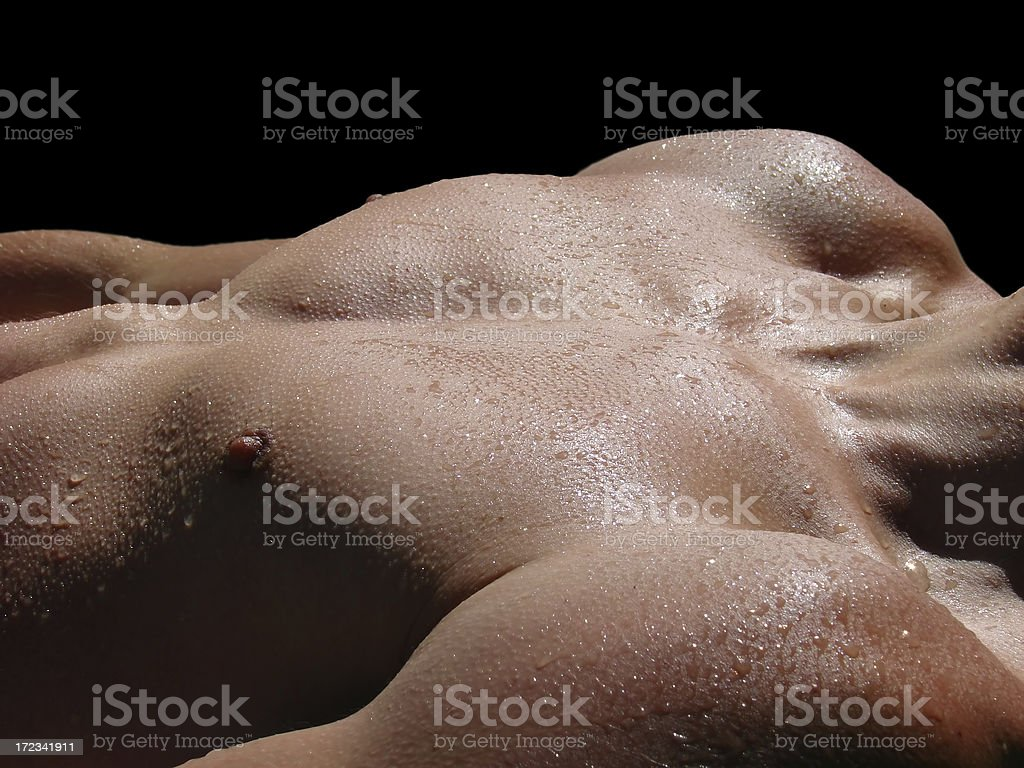 young male muscular body with water drops royalty-free stock photo