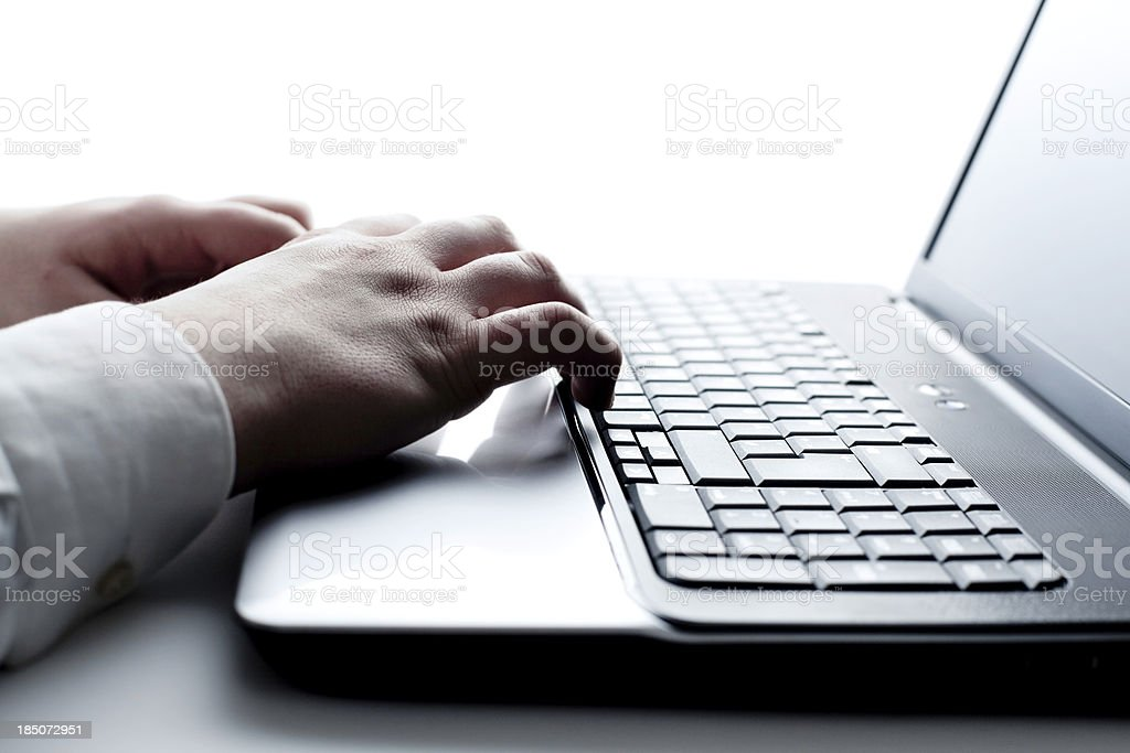 Young Male Office Worker on Laptop stock photo