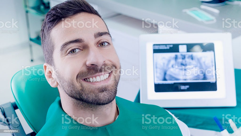Young male patient at the dentist office stock photo