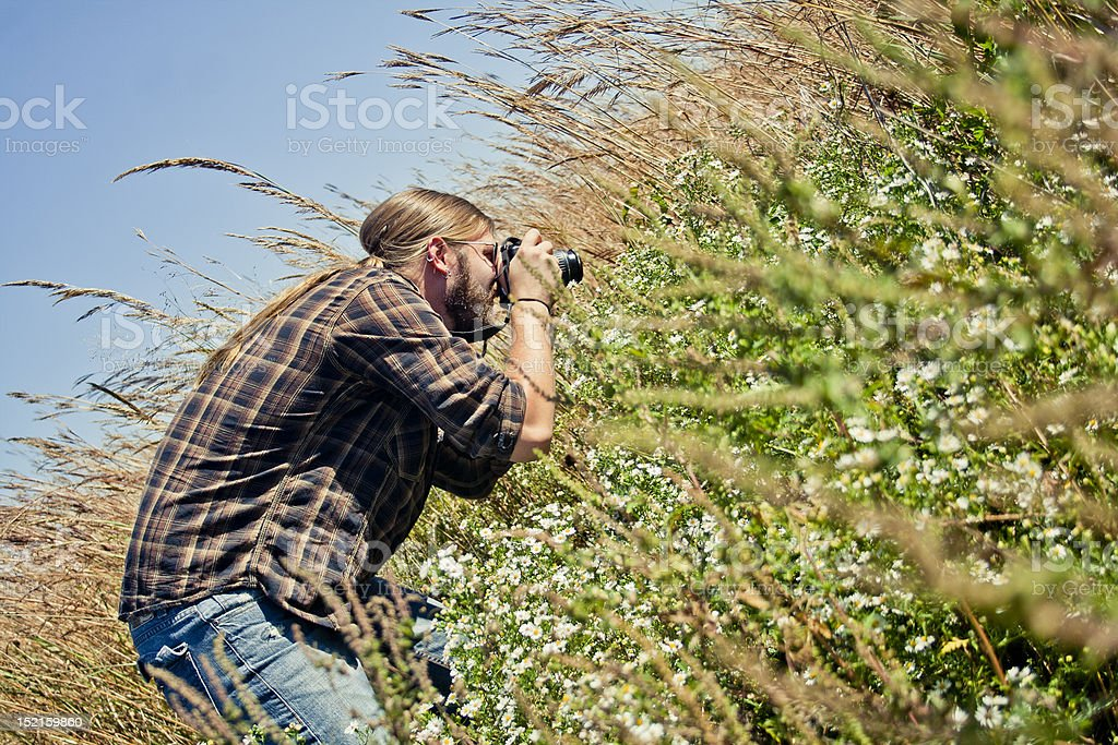 Young male photographs nature stock photo