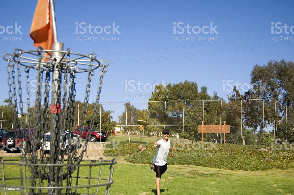 Young male playing Frisbee golf stock photo