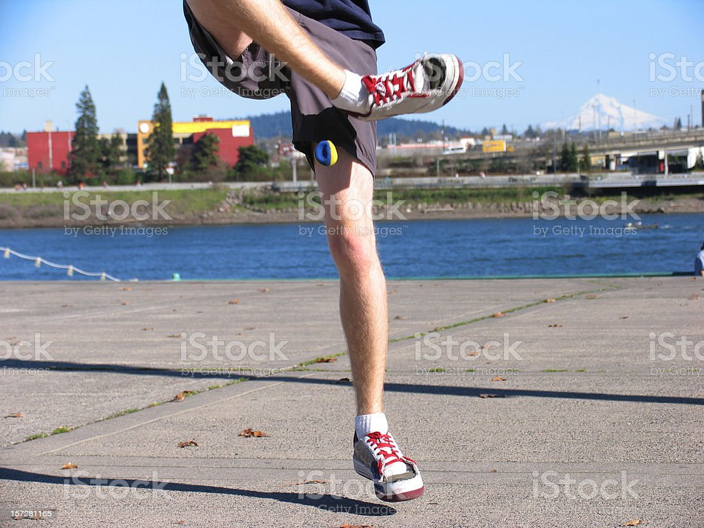 Young Male Playing Hacky Sack at Water Front stock photo
