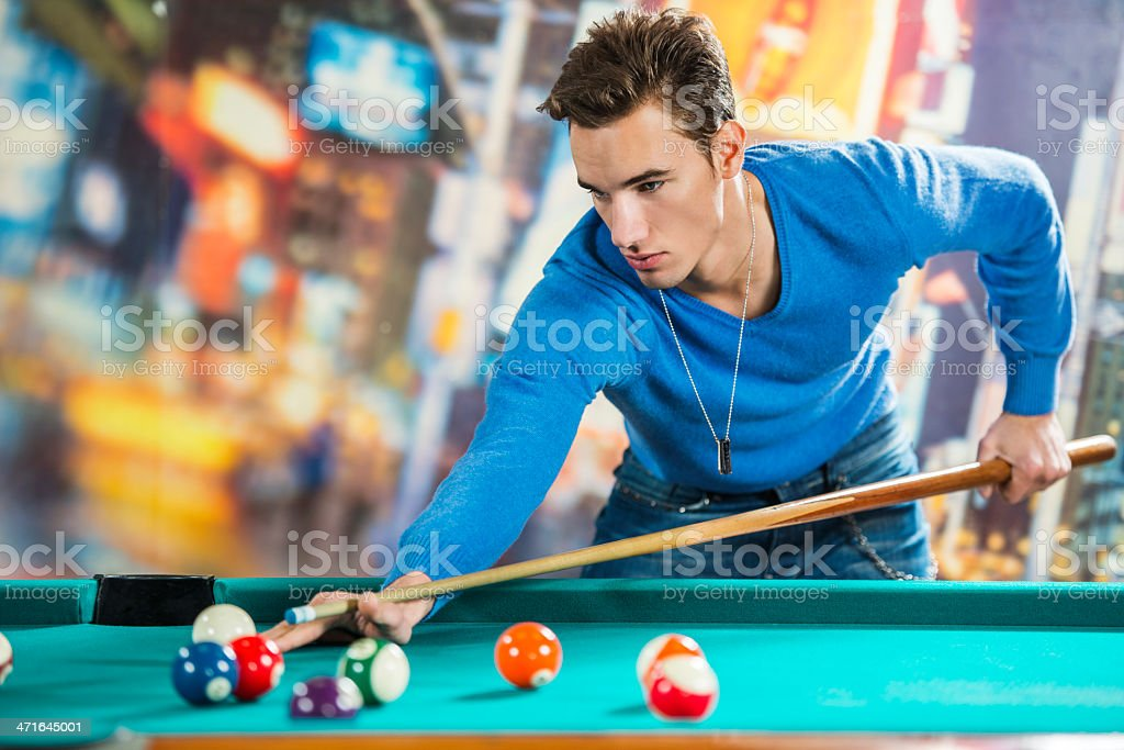 Young male playing snooker. royalty-free stock photo
