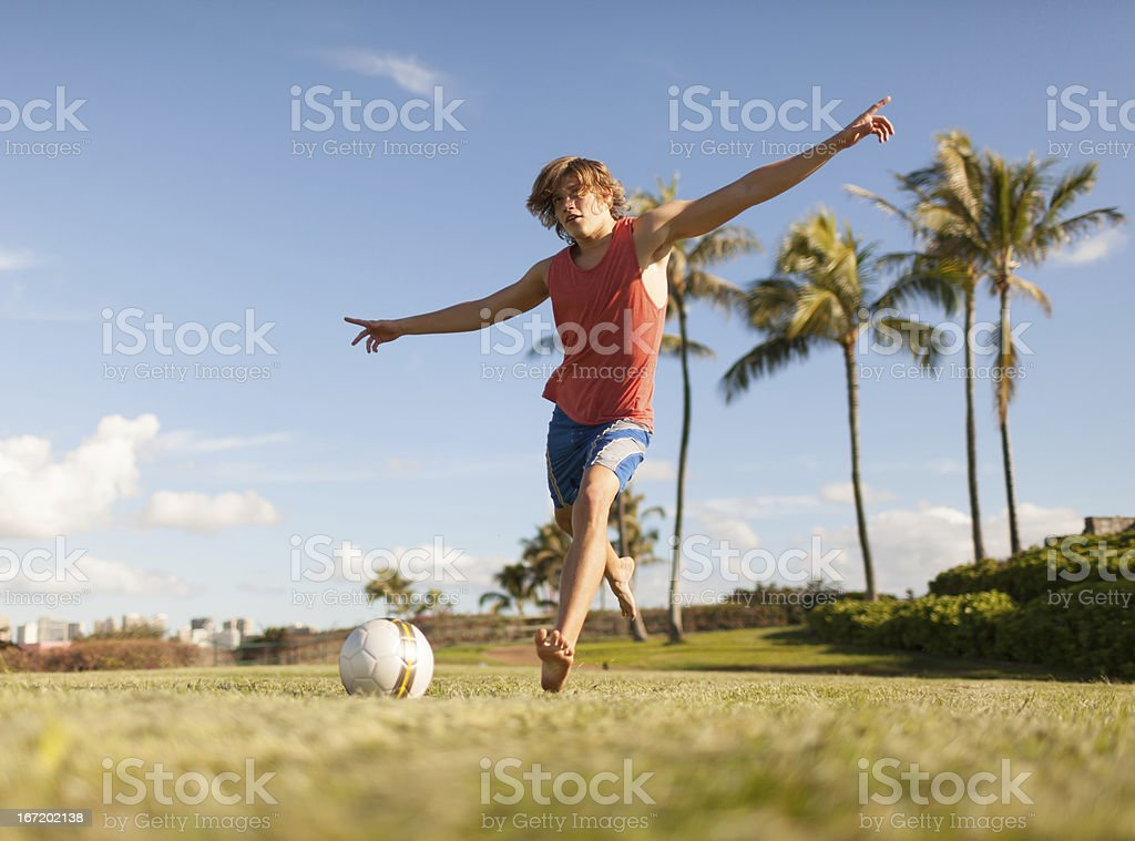 Young male playing soccer royalty-free stock photo