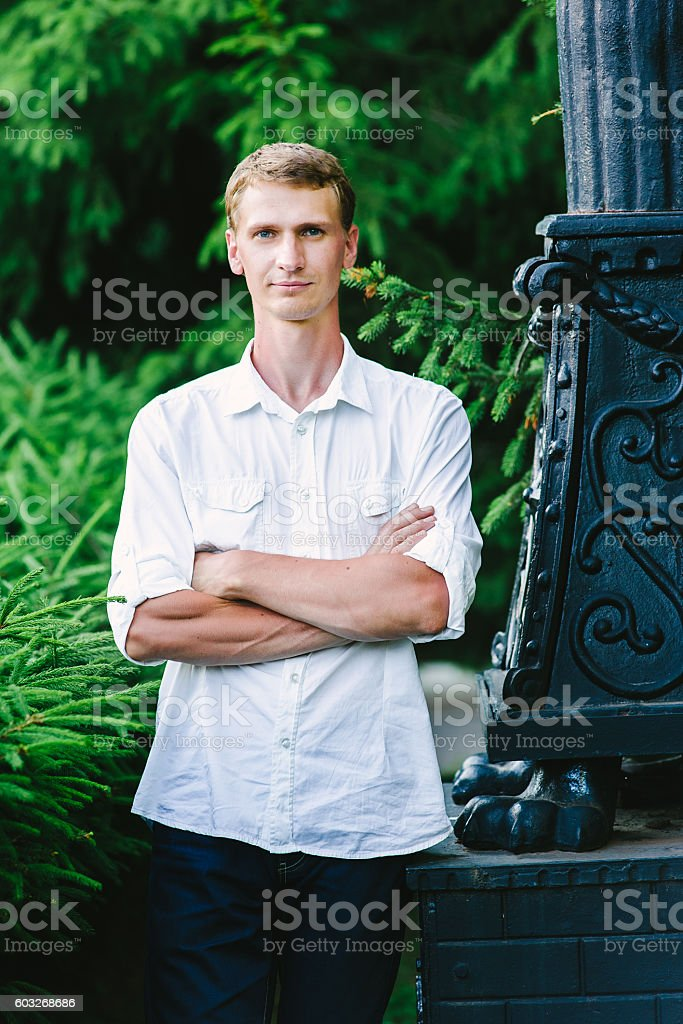 Young male portrait in nature stock photo