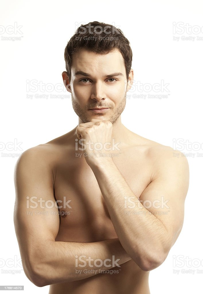 Young male posing shirtless with arms flexed royalty-free stock photo