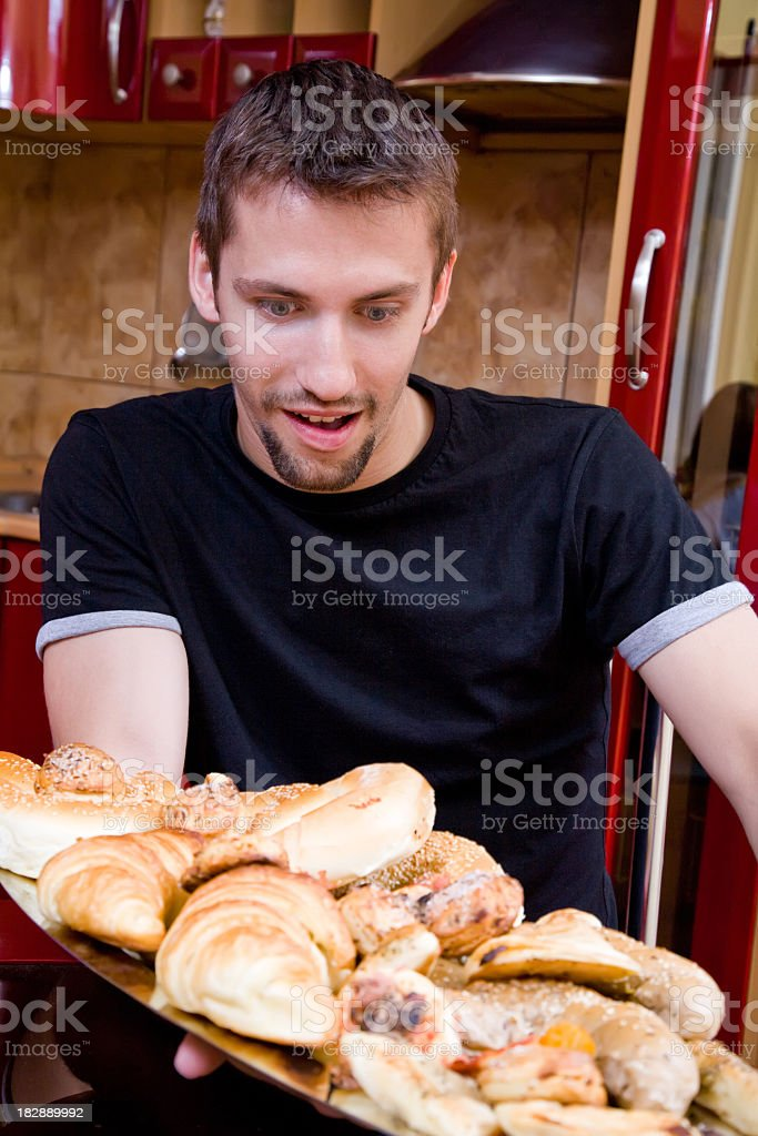 Young male preparing snacks royalty-free stock photo