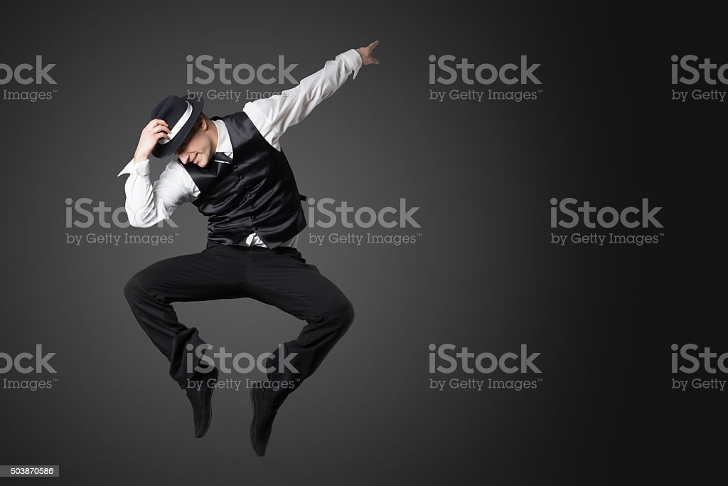 Young male professional dancer dancing in studio. stock photo