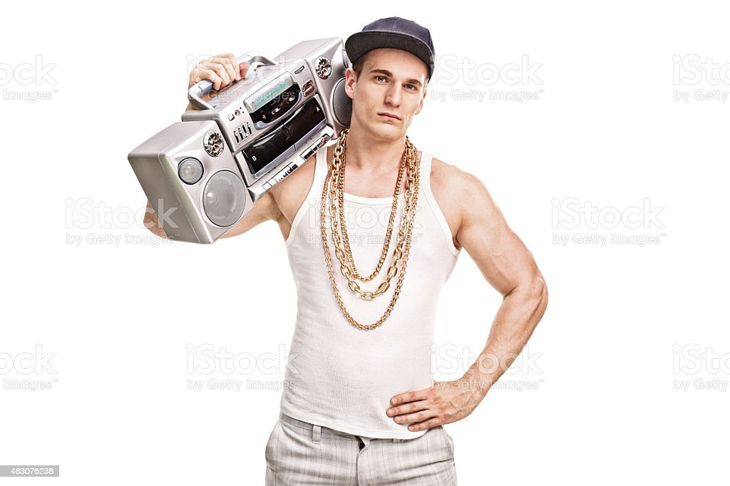 Young male rapper holding a ghetto blaster stock photo