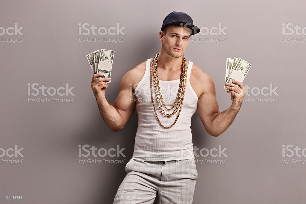 Young male rapper holding money stock photo