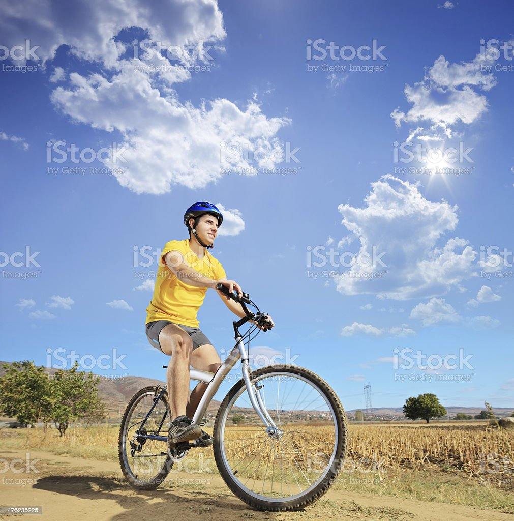 Young male riding a bike royalty-free stock photo