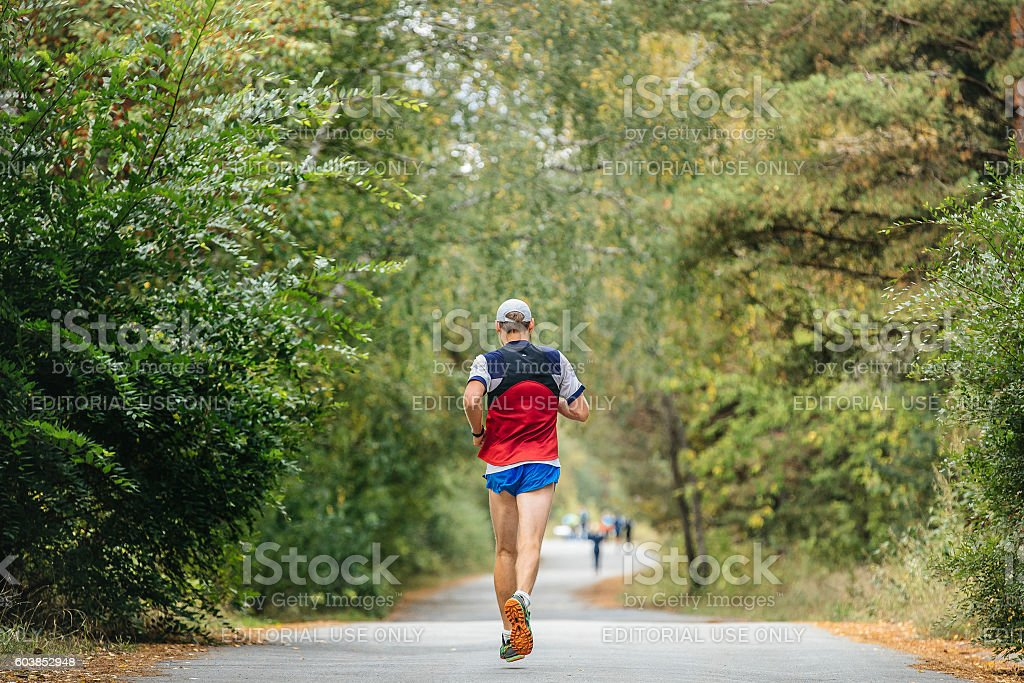 young male runner marathon running in autumn forest royalty-free 스톡 사진