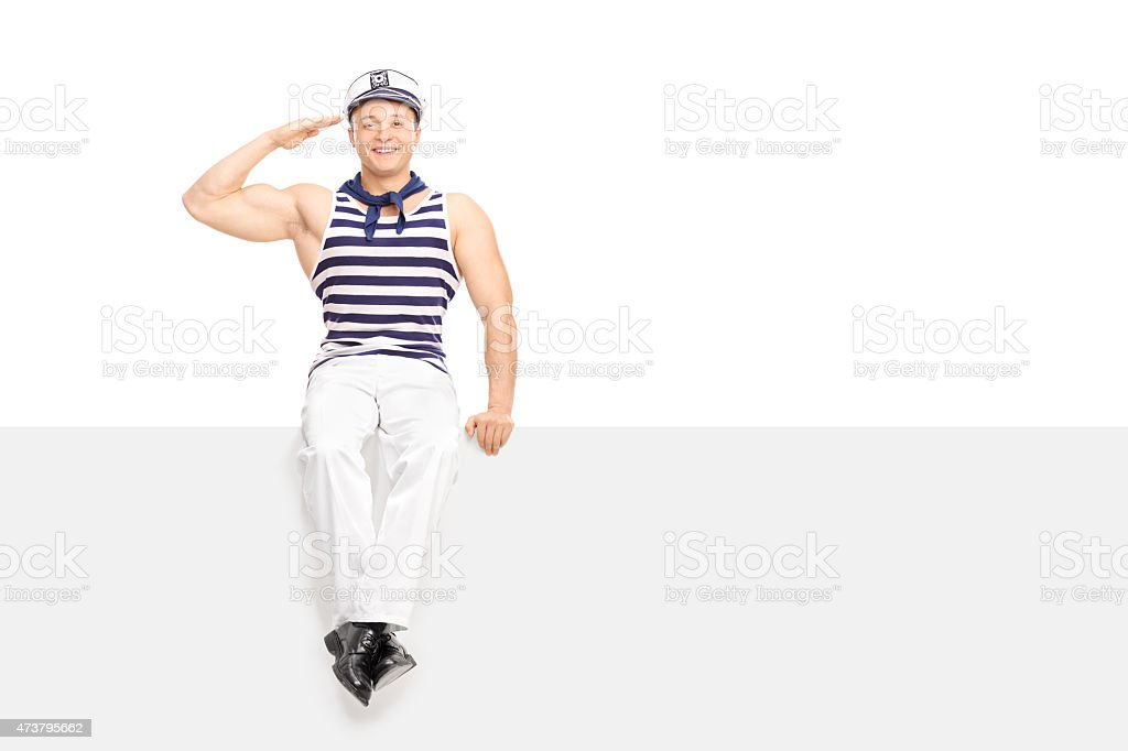 Young male sailor saluting towards the camera stock photo