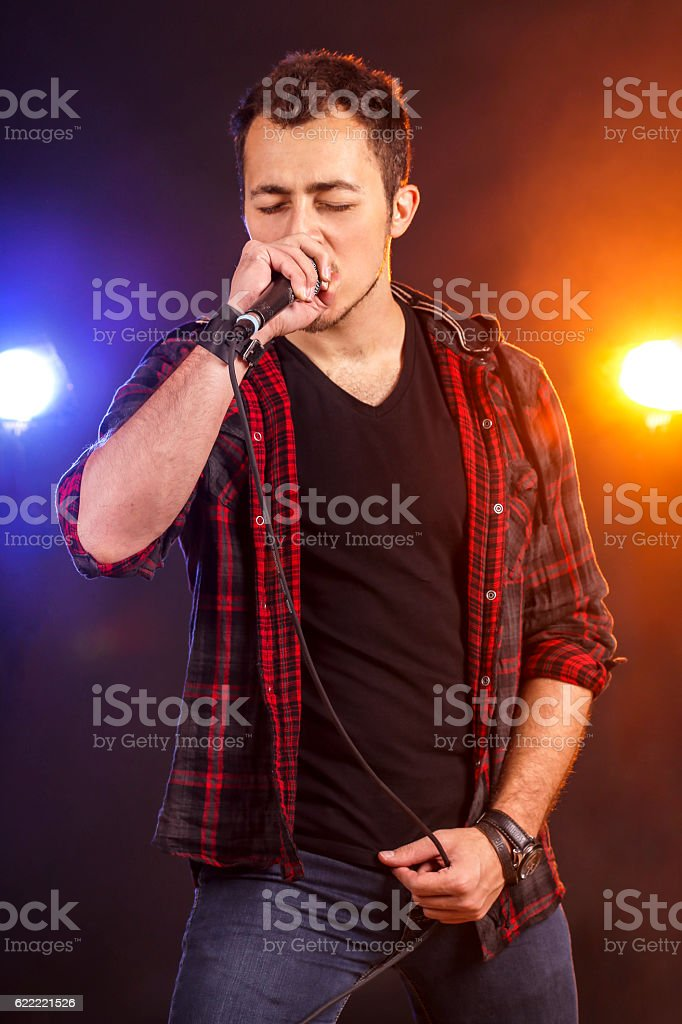 Young male singer stock photo