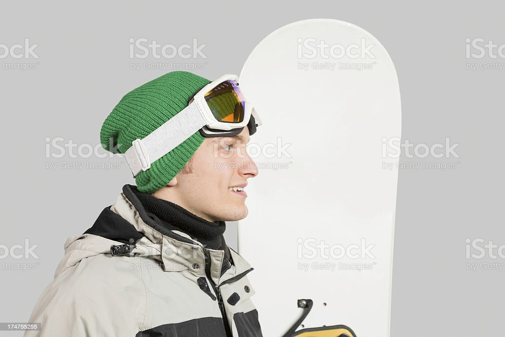 Young Male Snowboarder smiling profile isolated royalty-free stock photo