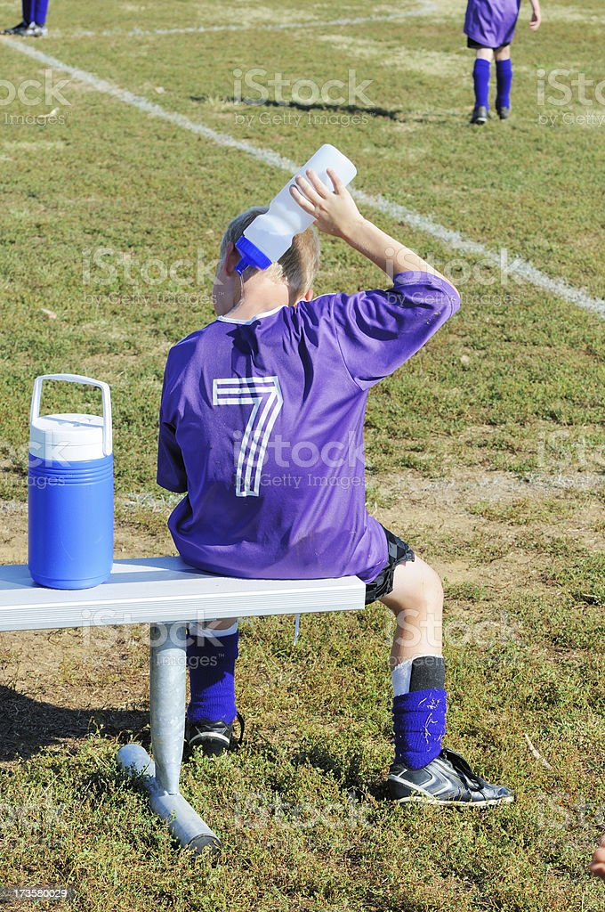 Young Male Soccer Playing Cooling Off During Game royalty-free stock photo