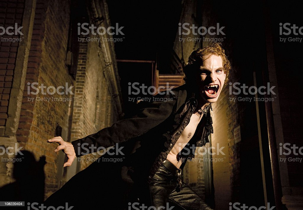 Young Male Vampire Hissing at the Camera stock photo