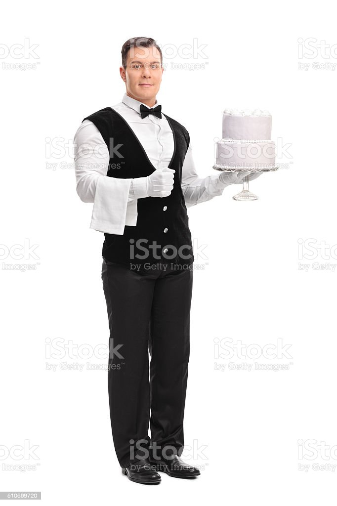 Young male waiter holding a cake stock photo