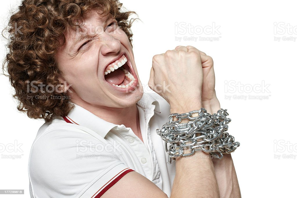 Young male with chained hands royalty-free stock photo