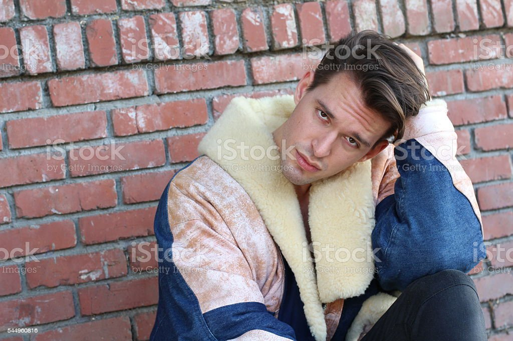 Young male with eclectic outfit and duckface expression stock photo