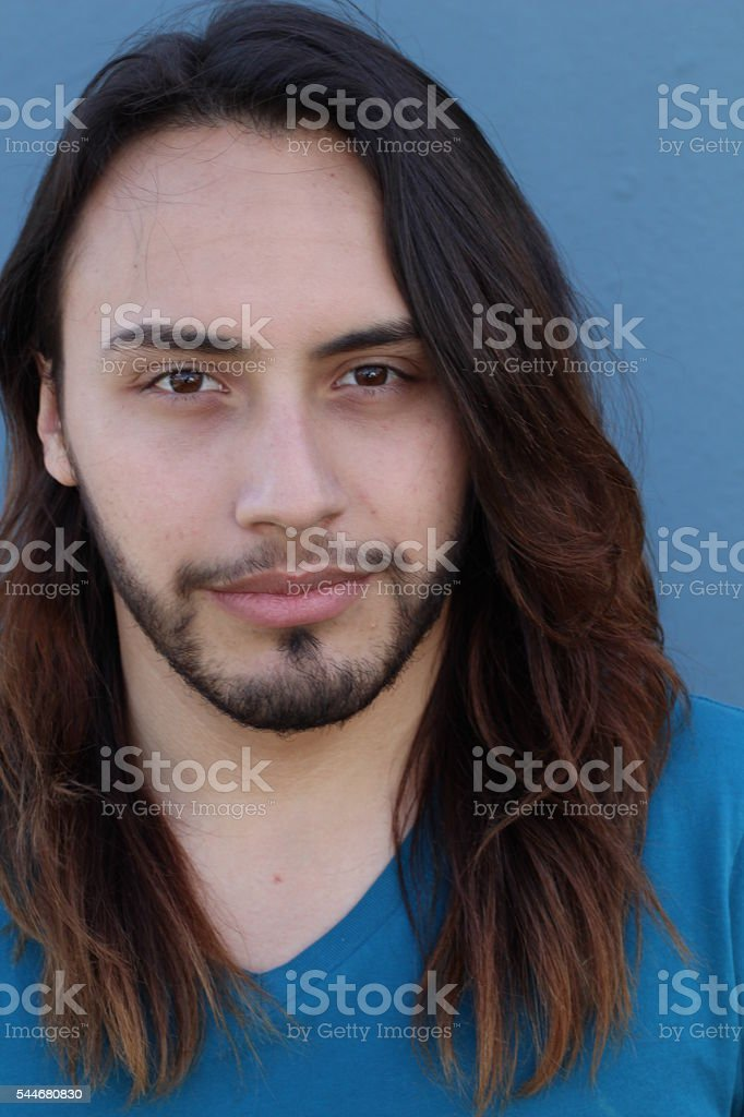 Young male with long hair and beard stock photo