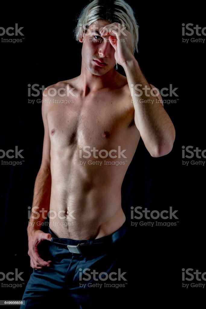 Young man about to start training. stock photo