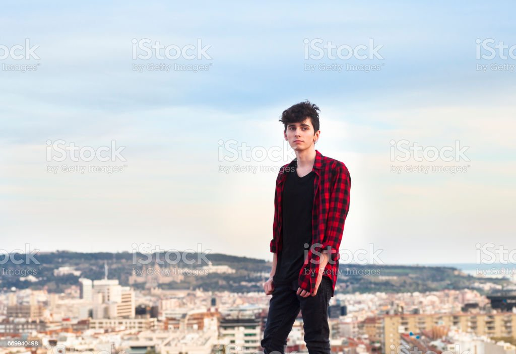 Young man above the city stock photo