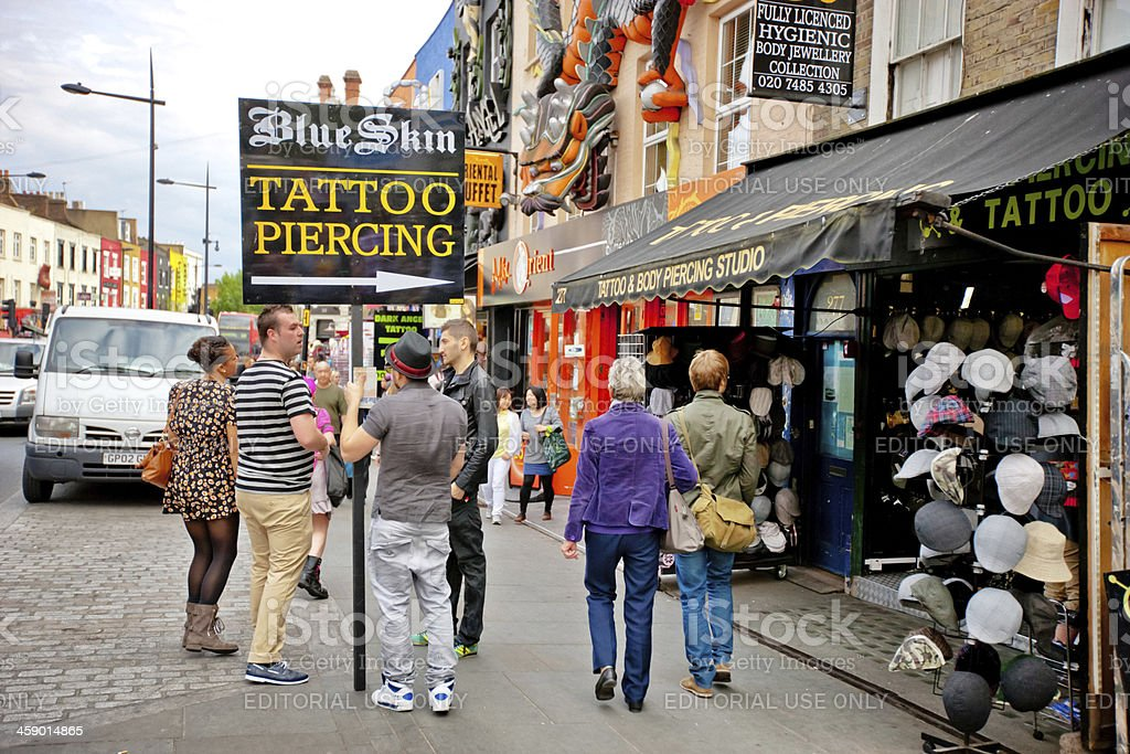Young Man Advertising Tattoo Studio in Camden Town, London royalty-free stock photo