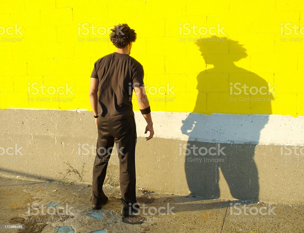 Young Man African Descent Standing Facing His Shadow Yellow Wall stock photo