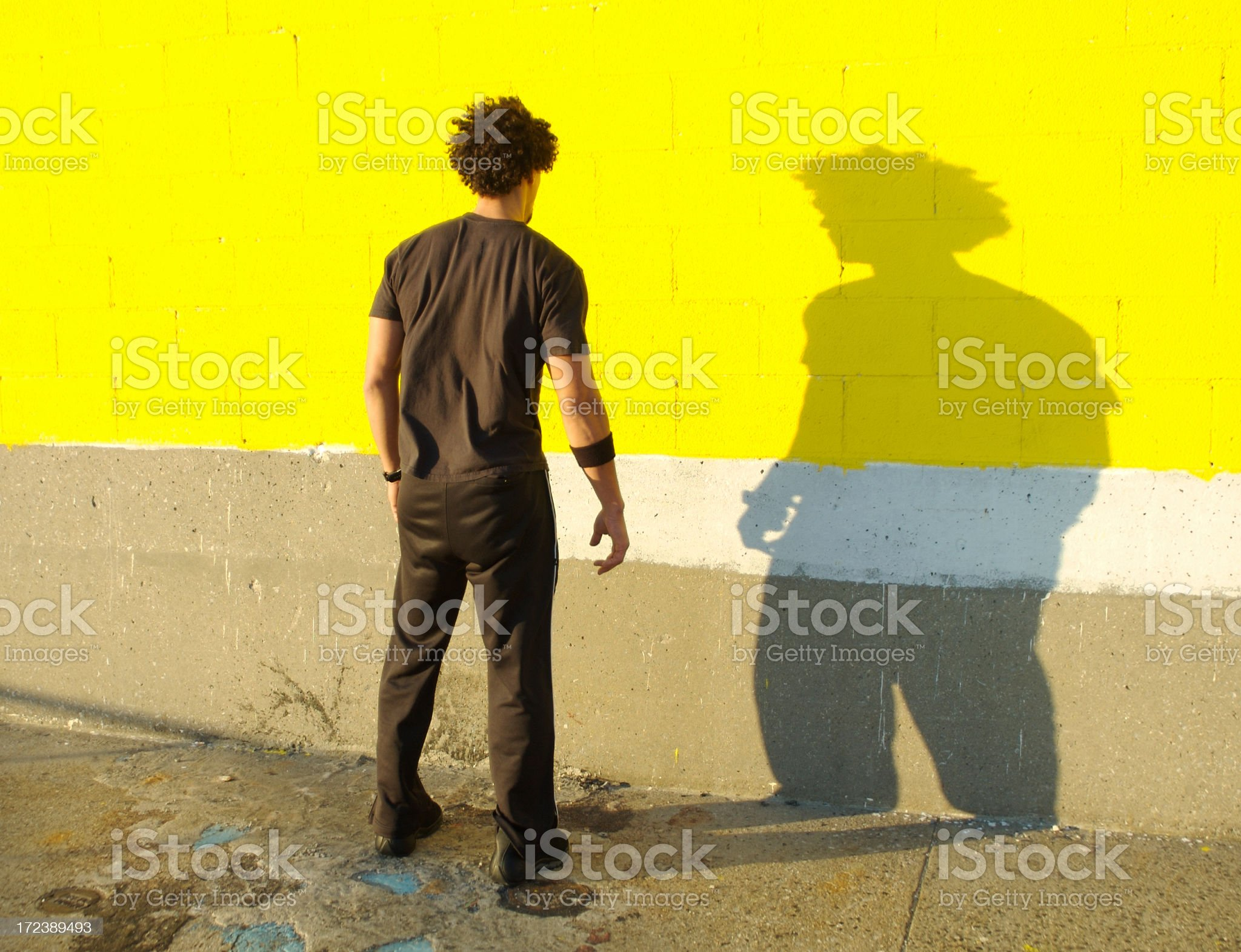 Young Man African Descent Standing Facing His Shadow Yellow Wall royalty-free stock photo