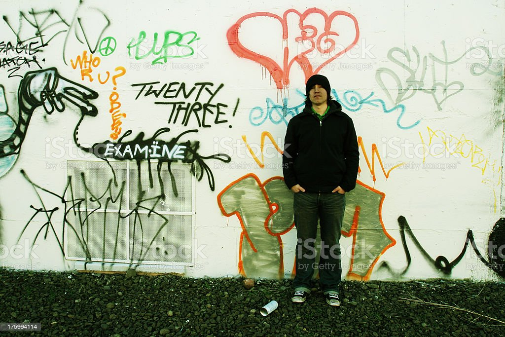 young man against graffiti royalty-free stock photo