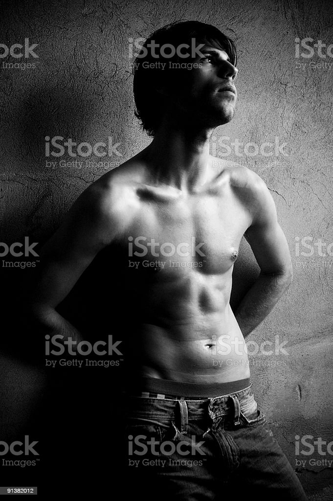 young man against wall stock photo