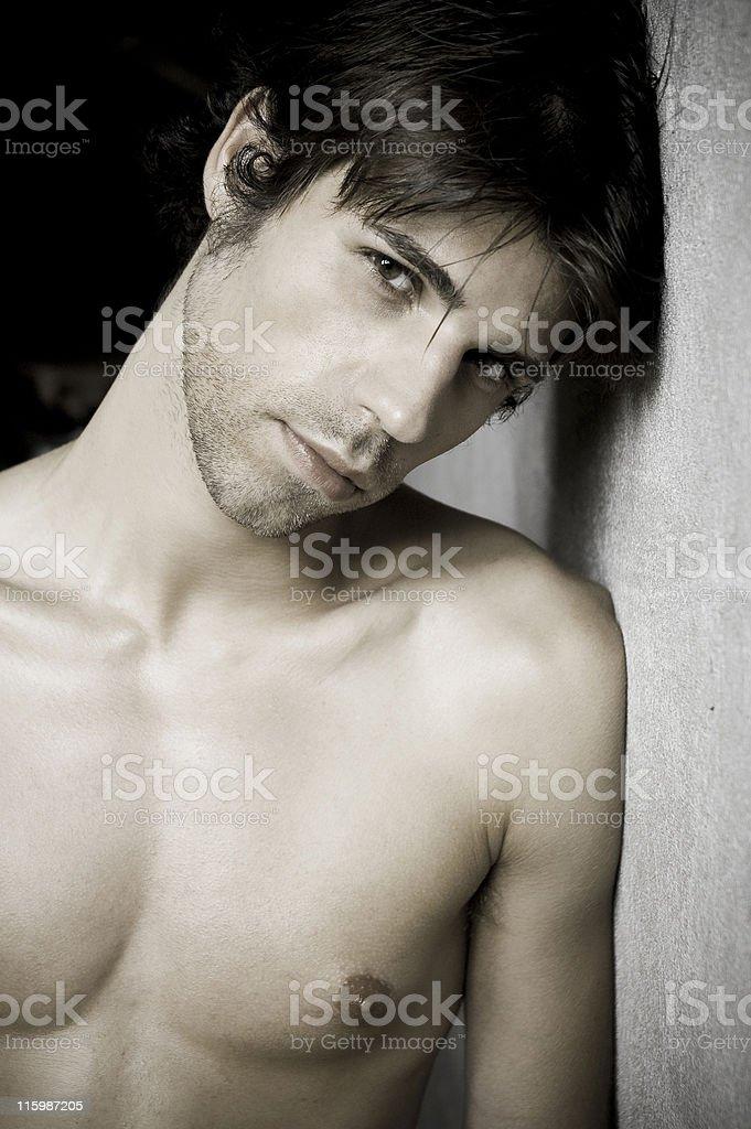 young man agaist wall royalty-free stock photo