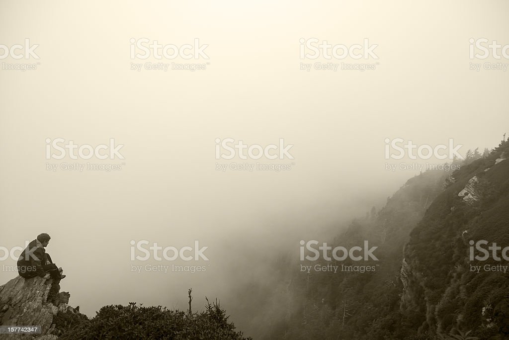 Young man alone in nature and clouds royalty-free stock photo
