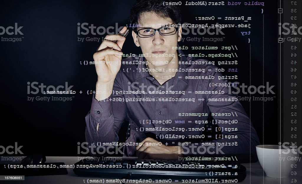 young man analyzing his java code royalty-free stock photo