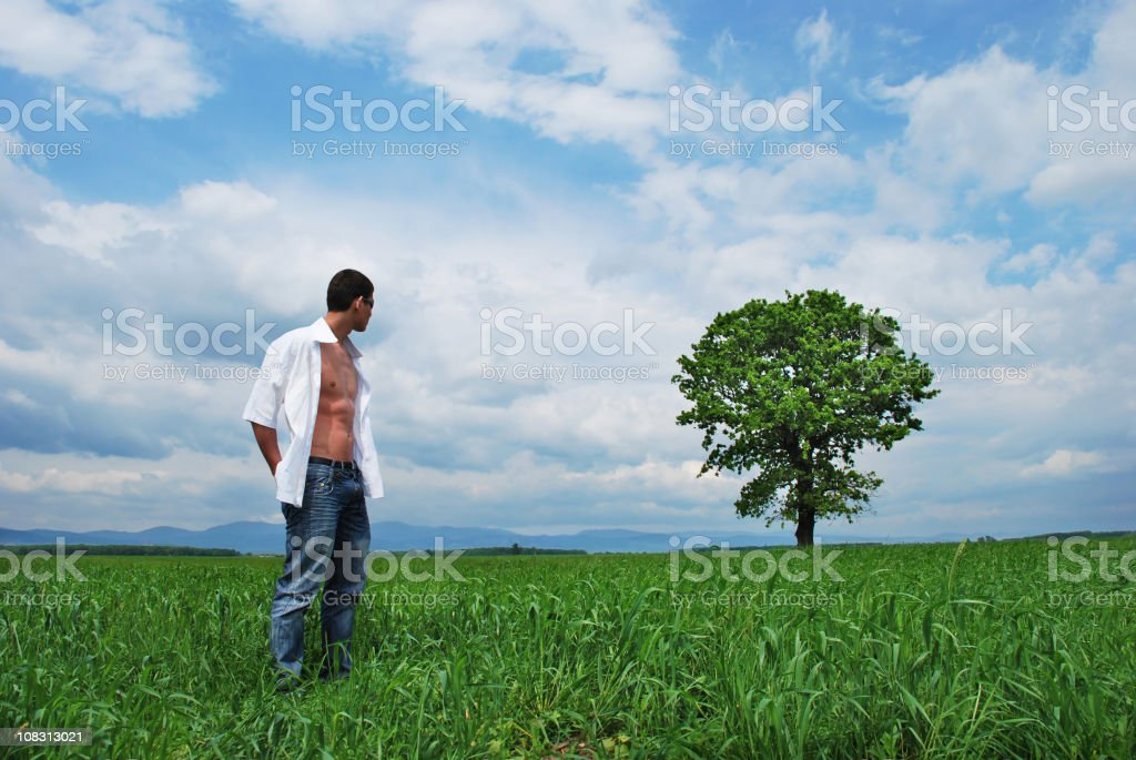 Young man and beautiful nature stock photo