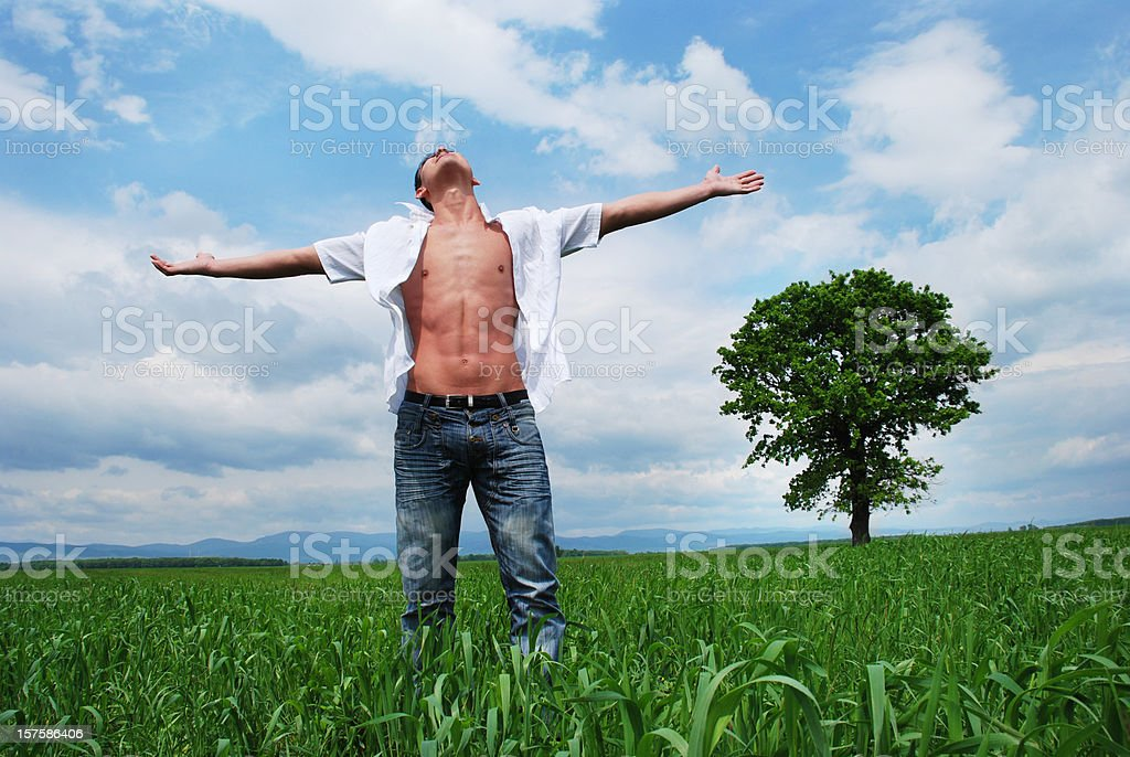 Young man and beautiful nature royalty-free stock photo