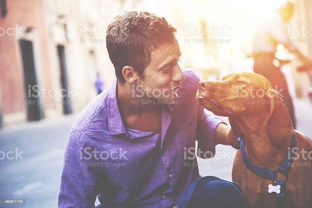 Young man and dog - True love royalty-free stock photo